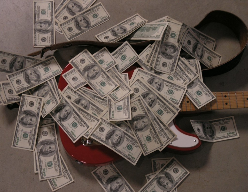 """""""It's hard to play when my guitar is covered in THIS MUCH MONEY"""""""